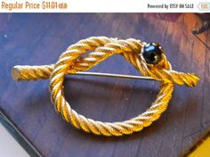 Items similar to Gold Rope Brooch Pin Nautical Themed Brooch Textured Brushed Gold Simple Looped Knot Design Accented with Black Glass Pearl on Etsy Loop Knot, Nautical Theme, Black Glass, Vintage Brooches, Brooch Pin, Knots, Vintage Fashion, Gift Ideas, Texture