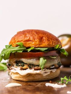 This easy, healthy chicken burger recipe is our homemade take on Murphy's chicken, bacon, spinach burger, an Atlanta institution. Toss out your turkey burger recipes because this chicken burger rivals Spinach Stuffed Chicken, Chicken Bacon, Healthy Chicken, Chicken Recipes, Ground Chicken Burgers, Turkey Burgers, Spinach Burgers, Salmon Burgers, Veggie Burgers