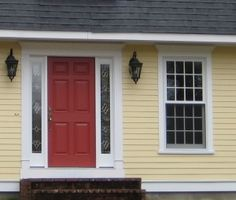Traditional Yellow (170) by Benjamin Moore, gives the house a cheerful, welcoming look. It's terrific with crisp white trim, a dark charcoal/black roof, wrought iron metal for lights, and a striking red door.