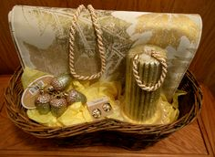 Gold and sparkly describes this basket!  Includes set of placemats, acorn ornaments, golden candle with glass plate, and pearl/gold jewelry set.