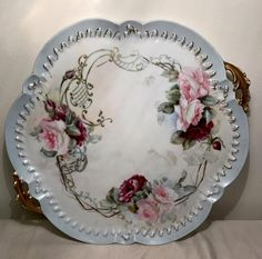 Gorgeous hand painted Limoges France Elite porcelain platter. Beautiful hand painted roses on platter front.. with gold painted trim an accents... There is fading and worn areas on some of the pain