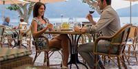 Enjoy a delicious meal on the terrace at the Albergo-Caffè Carcani, Ascona Carcani Hotel Group