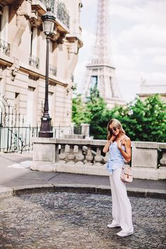 Baby blue top, white high-waist trousers and a Chloé bag with the Eiffel Tower on the background - Anna Pauliina, Arctic Vanilla blog.
