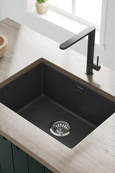 Our Vellamo Terra granite sink can be mounted inset or undermount - the perfect look for modern kitchens. It's vailable in three finishes - black, white or graphite grey and manufactured from 80% quartz composite giving it incredible strength! Granite Kitchen Sinks, Composite Sinks, Bowl Designs, Modern Kitchens, Graphite, Cleaning Wipes, Composition, Strength, Black White