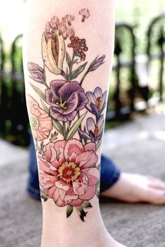 Alice Carrier Floral Leg tattoo. Love the pink flower