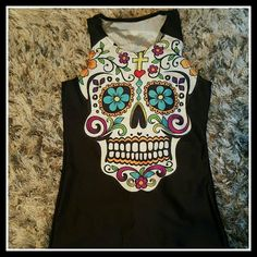 Colorful Day of The Dead Skull Racer Tank Top NWOT Colorful Day of The Dead Skull Tank Top New Without Tags. The material is not cotton, it's either Rayon or Nylon material. Racer back tank top. Tops Tank Tops