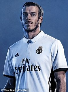 Gareth Bale poses in the new white home Real Madrid kit for the 2016-17 season