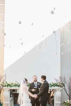 Single, delicate blooms were seemingly suspended from the sky, creating a light but dreamy ceiling of flowers.  {Floral design:  Everybody Loves Flowers   // Photography  Jessica Q Photography}