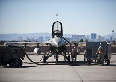 Crew chiefs assigned to the 20th Aircraft Maintenance Squadron, Shaw Air Force Base, S.C., work on an F-16 Fighting Falcon prior to a Red Flag 15-1 training sortie at Nellis Air Force Base, Nev., Feb. 10, 2015. Red Flag provides a series of intense air-to-air scenarios for aircrew and ground personnel to increase their combat readiness and effectiveness for future real-world operations. (U.S. Air Force photo by Staff Sgt. Siuta B. Ika)