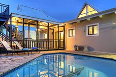 Brooms Estate Lodge, luxury self-catering villa on Prince's Grant Coastal Golf Estate, sleeps up to 12 people. Superb views of lagoon and ocean. Golf Holidays, Golf Estate, Kwazulu Natal, Holiday Accommodation, Wooden Decks, Bedroom With Ensuite, Great Restaurants, Beach Walk, Spa Treatments