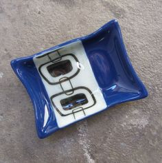 Cobalt blue glass soap dish- perfect to add a pop of blue to your bathroom decor.