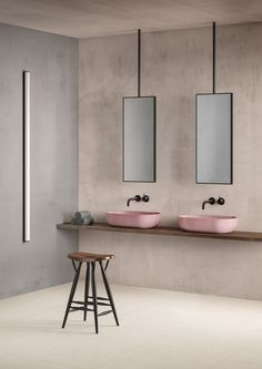 Amazing modern bathroom with his and hers sinks. Blush pink sink, with light limestone effect tiles.