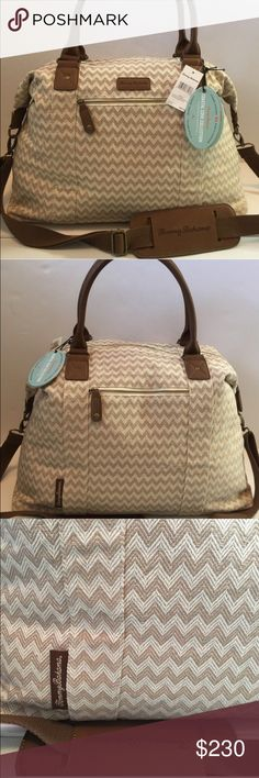 Tommy Bahama Chevron Travel Bag Beautiful chevron pattern bag with cream and tan and brown leather. Two side zip pockets and one zip pocket inside of bag. Gently used! Tommy Bahama Bags Travel Bags