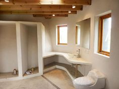 I am in <3 with this modern look in this earthbag bathroom!  Theres a ton of photos on this page of the Earthbag Building: La Casa Vergara