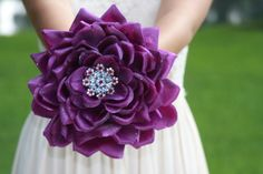 brooch bouquet alternative glamelia purple by TheCrystalFlower- this lady makes custom orders and that's about the price i would expect from any floral shop, maybe cheaper even @Elisabeth