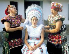 Matyo Bride From Hungary - In traditional Hungarian weddings, a brides attire usually includes an embroidered dress with floral patterns and three bright colors. She often wears many underskirts as well as an elaborate head-dress with wheat woven into it. Traditional Wedding Attire, Traditional Dresses, Traditional Weddings, Costume Ethnique, The Bride, Folk Clothing, Folk Dance, Folk Costume, Bridal Looks