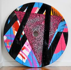THE JUXTAPOSITION OF WOOD GRAFFITI, SPLATTERED PAINT, PATTERNS AND GEOMETRICS SHOWS VIBRANCY OF COLOUR THAT CAN MANIFEST FROM GEOMETRIC CHAOS