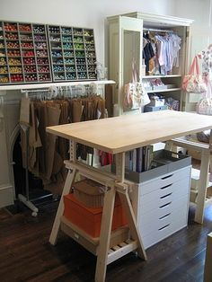 sewing space: love the idea of hanging the patterns, and just look at all that thread!