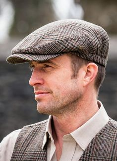 The Aran Sweater Market suggests you try on our Trinity Tweed Flat Cap in  Grey. Authentically made in Ireland using the finest Irish tweed fc9578a22647