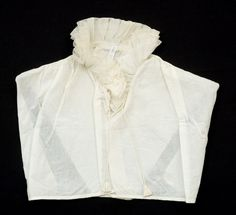 camisole, a woman's undergarment similar to a camisole, typically worn so as to be visible beneath an open-necked blouse or dress.