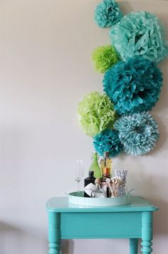 tissue pom flower backdrop   #DIY   http://www.mywedding.com/articles/fabric-and-paper-wedding-flowers/
