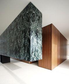 Belgian studio De Meester Vliegen Architecten overhauled an apartment at the top of a building in Antwerp
