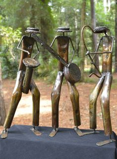 """Set of Musicians"" Recycled Metal Artwork. Set of 3 musicians at the end of a long day, enjoying making music together. By the artist: David. A growing number of Zimbabwe artisans are experimenting and using recycled metals to compose beautiful and engaging welded metal art pieces of native wildlife and lifestyle. 30% of net profits go back to 3 Zimbabwean charities."
