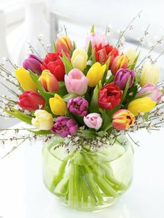 A beautifully arranged vase of fresh tulips is an elegant and stylish springtime gift.