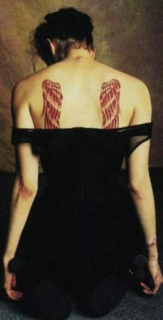 The Crow: City of Angels - Sarah's (Mia Kirshner) angels' wings tattoo