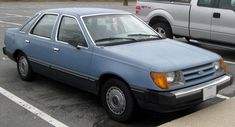 1984 Ford Tempo: Mine was 2 door, white with red interior.  Sound familiar?
