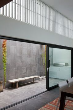 Stone ..........Near Melbourne, a design-savvy couple added multiplied volume and landscape behind a conventional midcentury facade.