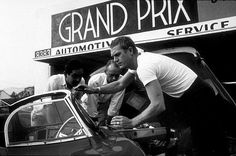 Steve McQueen with his XKSS Jaguar at Grand Prix Motors on Melrose Ave.
