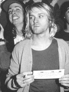 Kurt Cobain...and then there's Dave Grohl behind him:)