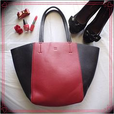 HP❤️Lord & Taylor Black & Red Tote❤️ Lord & Taylor leather tote with two straps and a snap closure. Snap closure has the plastic wrapping still protecting the silver hardware. Measurements in third pic. Black and red colors. NWOT Lord & Taylor Bags Totes