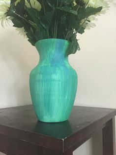 A personal favorite from my Etsy shop https://www.etsy.com/listing/467592220/handpainted-glass-vase