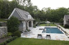traditional landscape guest house and in ground pool by Natchez Stone Company, LLC.