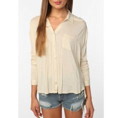 Urban outfitters Top Staring at stars Urban Outfitters knit button down high low top in cream. Has a small hole in the back next to the label. Open to all offers Urban Outfitters Tops Button Down Shirts