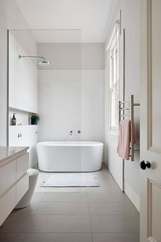 white bathroom Clifton Hill A Renovation This Clifton Hill project is a renovation to an existing two-storey Victorian terrace house. The existing house was due for a renovation, it had a steep staircase, a lack of connection to Bad Inspiration, Bathroom Inspiration, Bathroom Ideas, Bathroom Mirrors, Bathroom Cabinets, Bathroom Designs, Bathroom Inspo, Bathroom Faucets, Bathroom With Window