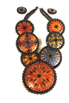 Necklace set put on a leather piece to attach pieces.  Pieces are decorated with wax.  Gourd Art by Miriam Joy