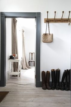 dark trim, white walls, whitewashed floors-- love this for office and mud entry Farmhouse Trim, Farmhouse Interior, Rustic Doors, Wood Doors, Workspaces Design, Door Frame Molding, Door Frames, Painting Wood Trim, Trim Paint Color