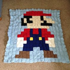 #SuperMario is finished! I have some ends to weave in still. I'll wash and block it when it's all finished. #pixelcrochet #pixelblanket #crochet