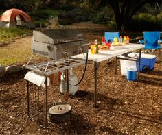 Lifetime Camping Tables - 80286 5.5 Foot Fold-in-Half Cooking Tailgate Table. This picture shows some food on the table.