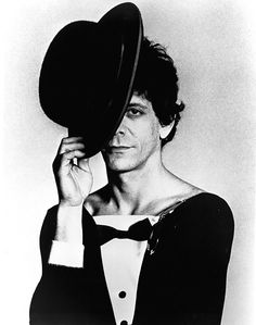 Walking on the Wild Side Lou Reed poses for a photograph dressed in a bowtie and hat, circa 1970