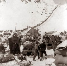 This photograph was taken in and shows miners who were part of the Klondike Gold Rush. Notice in the background the long ribbon of miners making their way up the snowy mountain (presumably over the Chilkoot Pass from Skagway). Canadian History, American History, Old Pictures, Old Photos, Rare Photos, Vintage Photographs, Vintage Photos, Titanic, History Photos