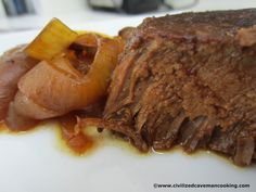Balsalmic Roast  2 Lb Top Round Beef or any Roast  1 Large Sweet Onion, sliced  8 Ounces Tomato Sauce  1/2 Cup Balsamic Vinegar  1/2 Cup Water  2 Tbsp White Wine  2 Tbsp Coconut Oil  Seasonings for Rub:  Salt  Smoked Paprika  Garlic Powder  Onion Powder  Black Pepper