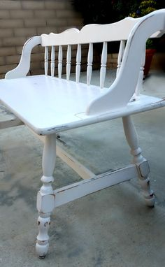 white lightly distressed spindle back bench by atomichostess