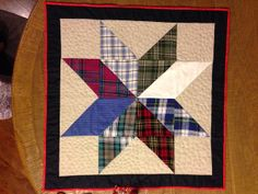 Memory Table Topper  This block is very clever use of 1/2 square triangles squares arranged and then matched up to make a star block.  I really need to use this for the cowgirl fabric quilt.