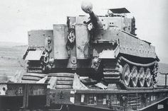 Tiger with narrow conveyor belts on a freight wagon. Note the sejmutých casters wheels which are piled up behind the tank
