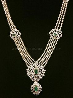 Beautiful ball haram with diamond pendant and side lockets. For inquiries please contact the seller below. Seller Name : Lakshmi Jewellers Contact : 095505 99709 Related PostsDiamond Emerald Necklace From Lakshmi JewellersDiamond Bridal Jewellery Set From P. Satyanarayan & SonsComplete Diamond Bridal Necklace SetImitation Step Haram With JhumkaGold Balls Mala with Side Diamond MogappuDesigner Diamond …