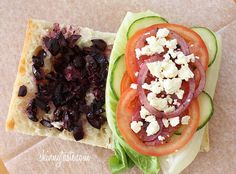 Greek Salad Sandwich - his is a great sandwich, it's meatless but has plenty of flavor from the olives and feta. You can even add some sun dried tomatoes.  #vegetarian